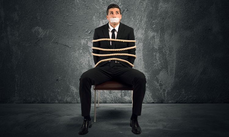businessman tied to a chair
