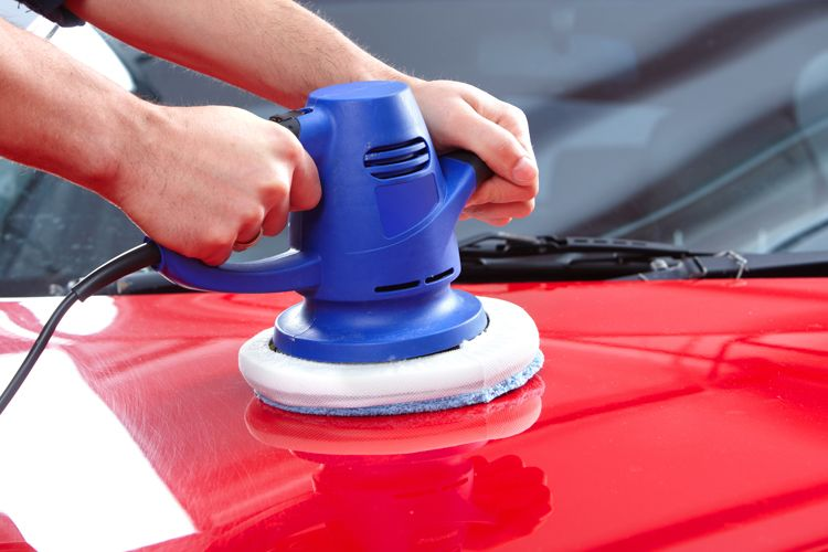 waxing car with orbital polisher