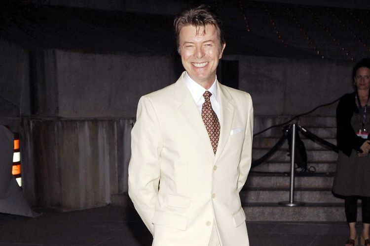 david bowie wearing a white suit