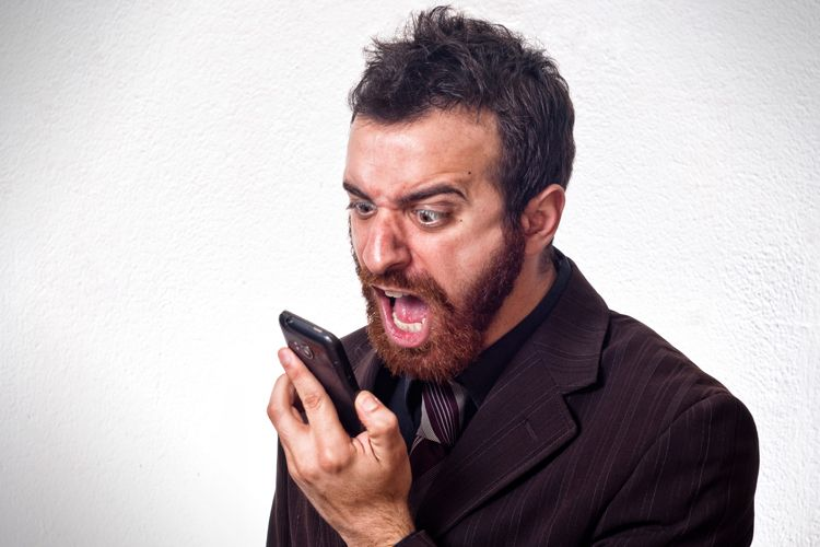 man screaming at phone