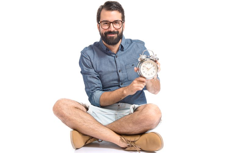man sitting with a clock