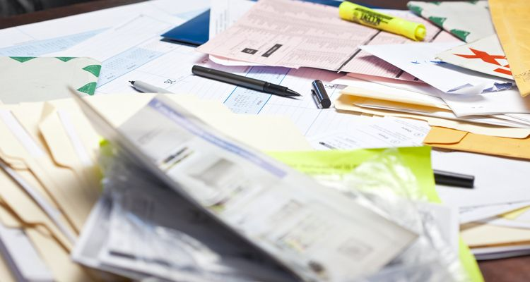 paperwork cluttering up a desk