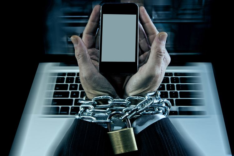 chained to phone and computer