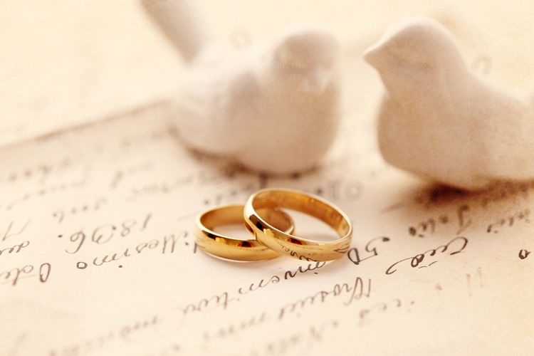 wedding rings on invite with doves