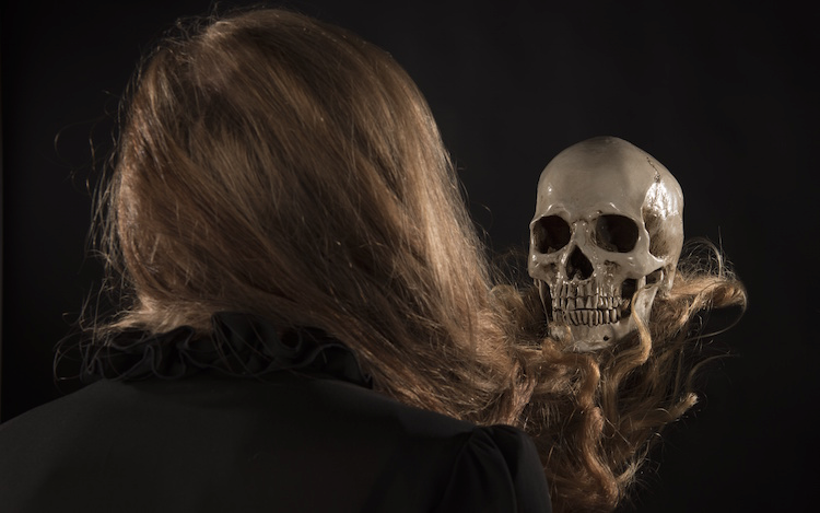 woman looking at her skull