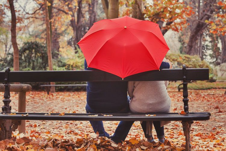 couple sharing umbrella