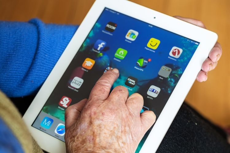 elderly person using an ipad
