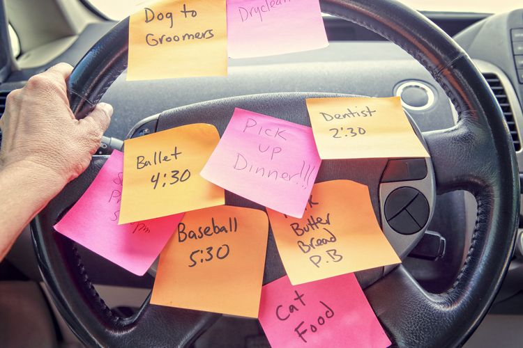 postit notes on steering wheel