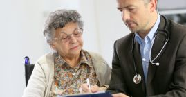 doctor speaking with elderly patient