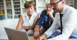 financial advisor with an older couple