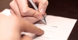 signing an official document