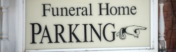 funeral home parking sign